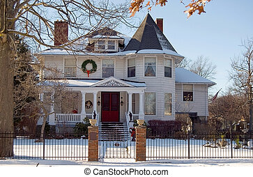 Victorian Christmas - Christmas wreaths on Victorian home in...