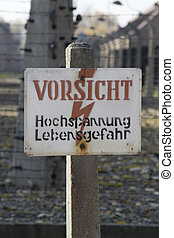 Auschwitz concentration camp - high voltage warning - Museum...