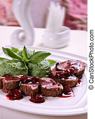 Grilled veal meat with potato mash in cherry sauce
