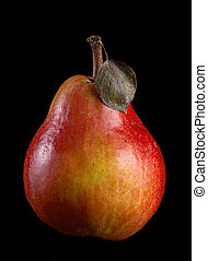 Red pear ripe fruit isolated on black background