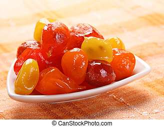 Candided fruit lemon tangerine orange in white plate detail