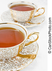 Two gold cup of tea - Two cup of tea from gold porcelain...