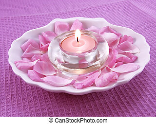 Aroma candle and petals of rose