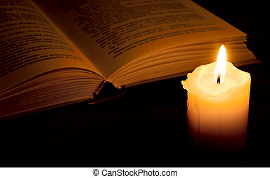 Book in candlelight