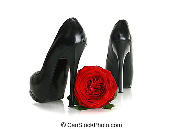 Black high-heeled shoes and a red rose. - Black high-heeled...