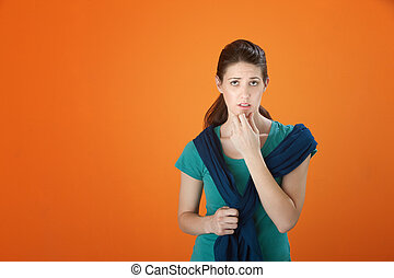 Serious Thinking Girl - Woman with fingers on chin must make...