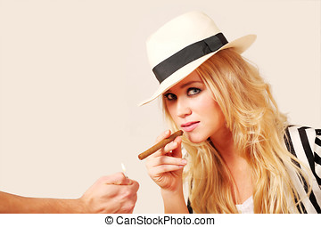 Stylish female lighting cigar - Lifestyle image with stylish...