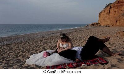 Two people in love - Newlyweds relax on a paradise island
