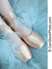 Pink Ballet Slippers and Tutu - Close-up of ballet slippers...