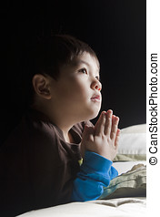Saying his prayers before bed - A young boy says his prayers...