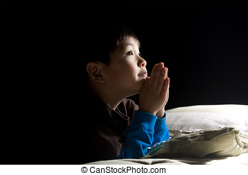 Young boys bedtime prayer - A young boy says his prayers...