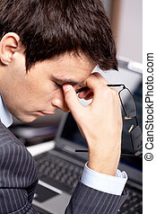 Tiredness - Photo of fatigue man with his eyeglasses off...