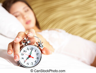 Time to wake up - Image of female hand on top of alarm clock...