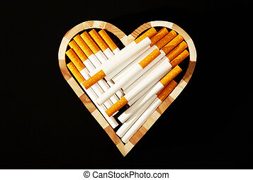 Love and cigarettes - Cigarettes in heart shape against...