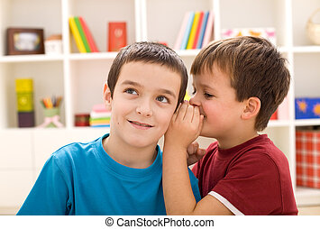 Two boys sharing a secret