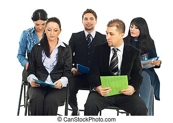 Business people at conference - Five business people sitting...
