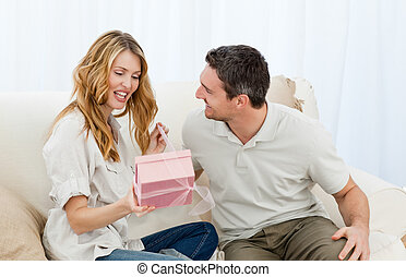 Man offering a gift to his wife