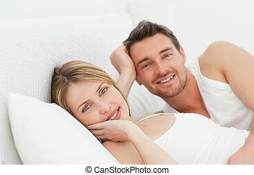 Cute couple lying down together in
