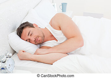 A man in his bed before waking up