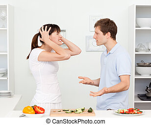 Young lovers having dispute in the kitchen