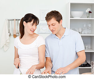 Lovers cooking together in the kitchen