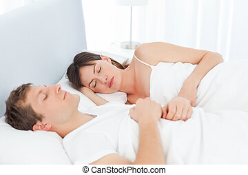 Peaceful lovers sleeping together