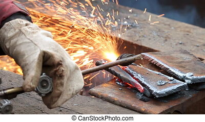 Gas welding - Man works with the welding device