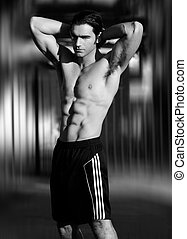 Sexy male fitness model - Black and white portrait of a sexy...