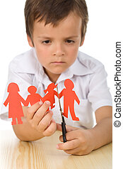 Sad boy cutting paper people family - divorce concept - Sad...