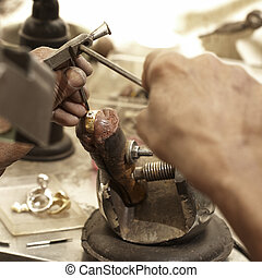 goldsmith making ring - hardworking Goldsmith working on an...