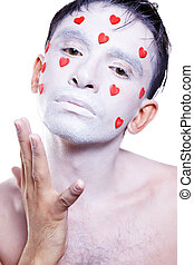 man with white makeup and red hearts