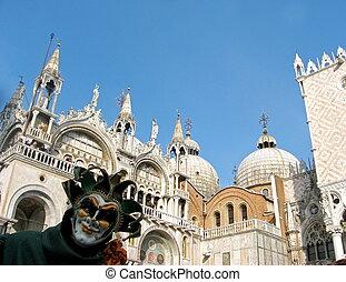 Mask at Carnival in St. Mark Square in Venice
