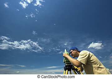 Surveying under blue sky
