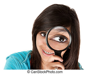 Big Eye - Young girl looking through a magnifying glass