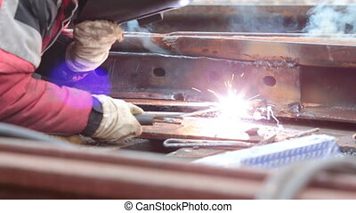 Electric welding - Man works with the welding device