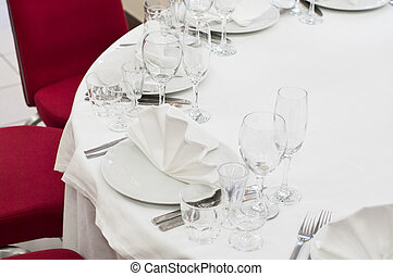 Elegant banquet and dinner tables prepared for a holiday or...