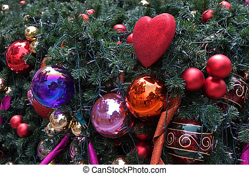 Cristmas - Festive red and gold ornaments on a Christmas...
