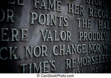 Valor spelled out on a copper monument with vignetting