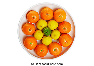 Bowl of citrus fruits isolated on a white background.