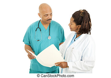 Medical Doctors Reading Chart - Attractive african-american...