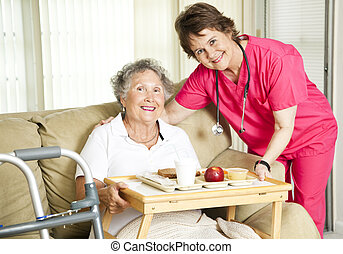 Lunch at the Nursing Home - Friendly nurse brings a mean to...