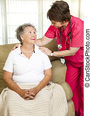 Senior Assisted Living - Nurse helps senior woman Could...
