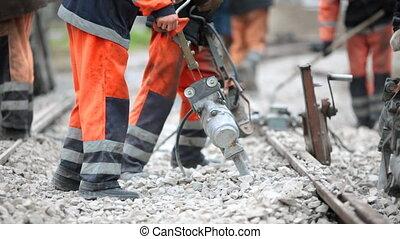 Tie tamping - Workers repair the railway