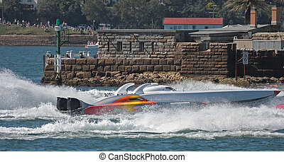 Powerboats racing near Fort Denison in Sydney Harbour