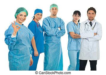 Surgeon woman give okay sign