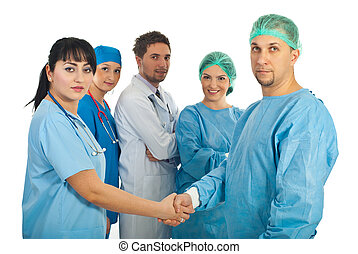 Physician woman and surgeon man handshake and their team of...