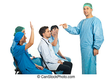 Doctor knowledge - Surgeon man questioning colleagues at...
