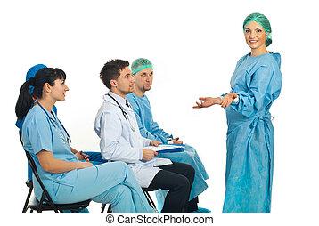 Confused surgeon woman at seminar