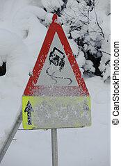 traffic sign at winter - traffic sign at road warns of snow...
