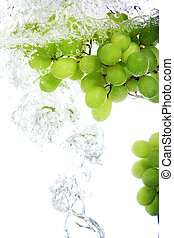 Grape dropped into water - Fresh vine grape dropped into...